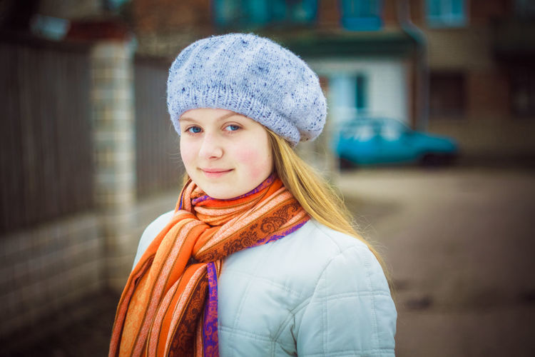 teen girl wearing white beret and orange scarf in windy day 20s Autumn Casual Elégance Fashion Green Hair Inner Power Orange Adolescence  Barret Beutiful  Blond Bonnet Cap Face Female Girl Looking Outdoor People Scarf Street Teenager Women This Is Natural Beauty