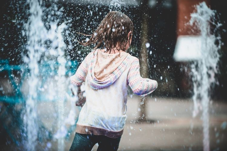 Casual Clothing Water Lifestyles One Person Real People Leisure Activity Rear View Splashing Child