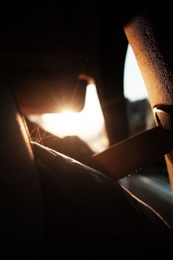 Close-up of lit candles in car