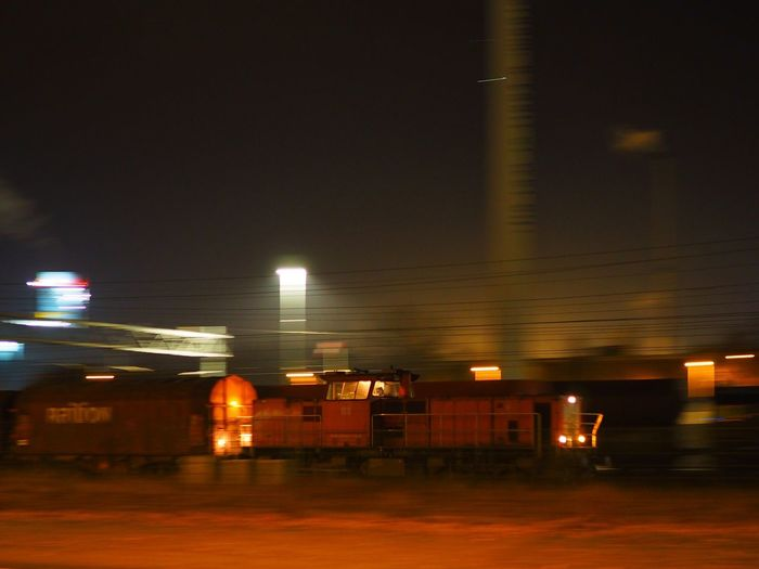 Architecture Blurred Motion Building Exterior Built Structure Freight Freight Transportation Illuminated Industrial Industrial Landscapes Industrial Photography Lighting Equipment Night No People Outdoors Train