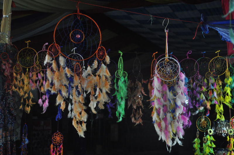 Low angle view of multi colored decoration hanging for dasale at market