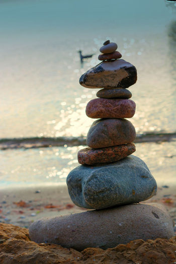 Stones stacked on top of each other on the beach with sea view in the background Balance Beach Close-up Focus On Foreground Horizon Over Water Land Nature No People Outdoors Pebble Rock Rock - Object Sea Sky Solid Stack Stone Stone - Object Tranquility Water Zen-like
