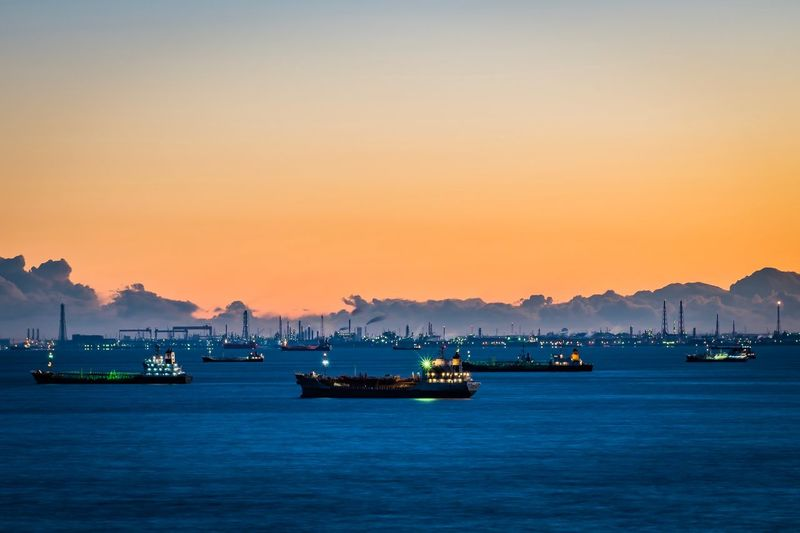 Ships in the morning Nautical Vessel Sunset Transportation Sea Mountain Scenics Water Freight Transportation Nature Harbor Mode Of Transport Outdoors Sky Tranquil Scene Commercial Dock Travel Destinations Beauty In Nature Tranquility Ship Clear Sky