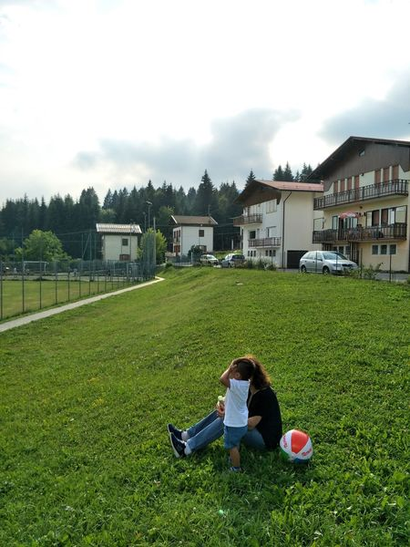 Vacation Time Two People House Building Exterior Grass Togetherness Childhood Full Length Child Architecture People Built Structure Adult Cloud - Sky Day Sky Boys Outdoors Rural Scene Men Bonding Family Mountain Greenery