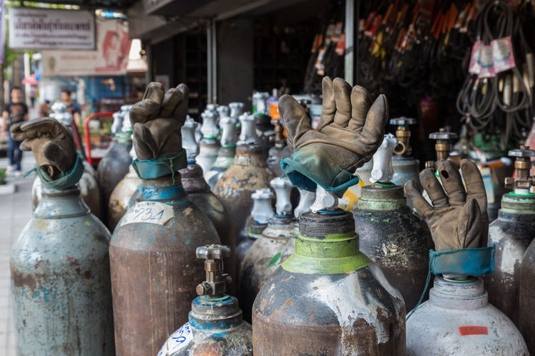 View of oxygen cylinders with handgloves in front of hardware shop