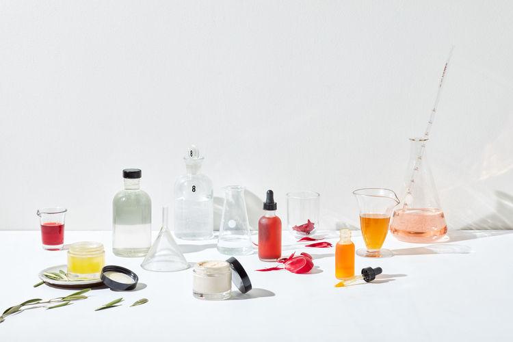 Bottles on table against white background