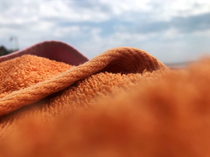 Greece Beach Fabric Towels Towel Orange Cloud - Sky Sky Close-up Brown No People Day Selective Focus Softness Personal Accessory Pattern Still Life Focus On Foreground Outdoors Land