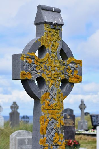 Celtic cross in cemetery Cross Religion Belief Cemetery Spirituality Grave Sky Tombstone No People Cloud - Sky Focus On Foreground Stone Material Outdoors Stone Day