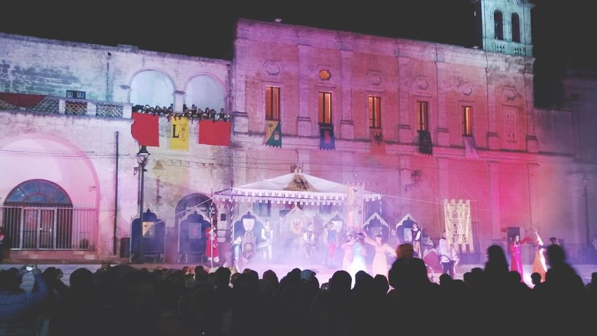 Oria,Brindisi Puglia South Italy Pink Color Celebrating Illuminated Night Large Group Of People Crowd Historical Parade Millennial Pink
