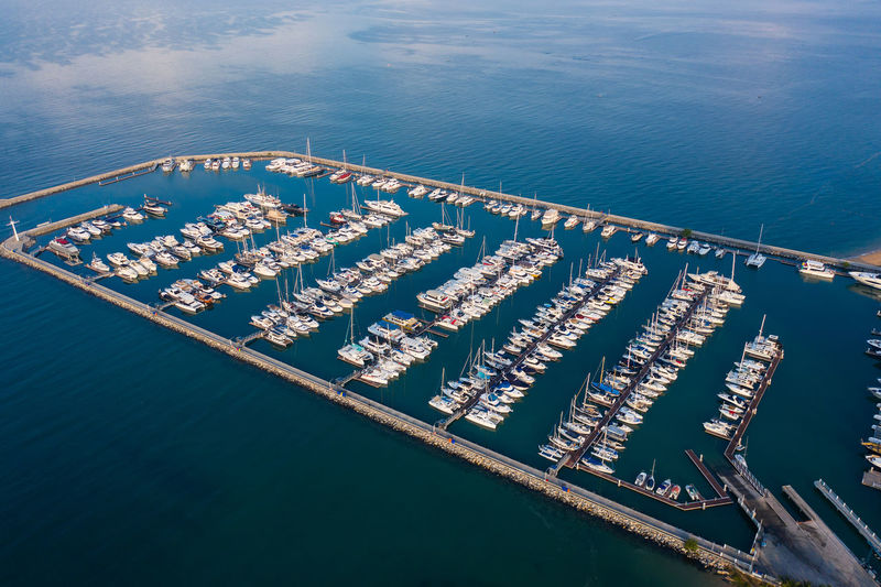 Aerial view of a white motor yacht. yacht enters the bay in the parking lot.