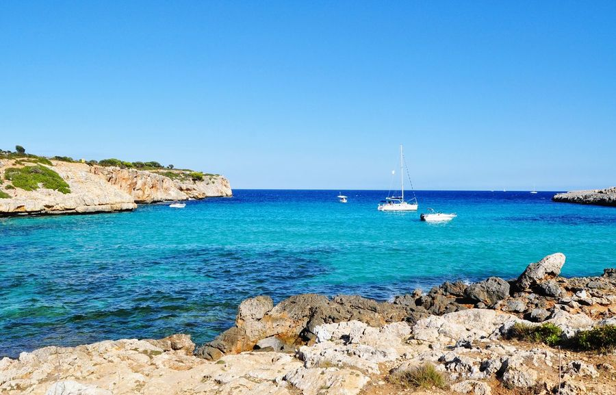 EyeEm Selects cala varques mallorca Sea Beach Sunny Water Rock - Object Travel Destinations Nautical Vessel Yacht Sky No People Idyllic Mallorca Mediterranean  Island Majorca Landscape Cala Varques