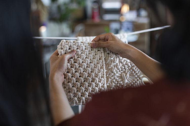Close-up of woman knitting wool