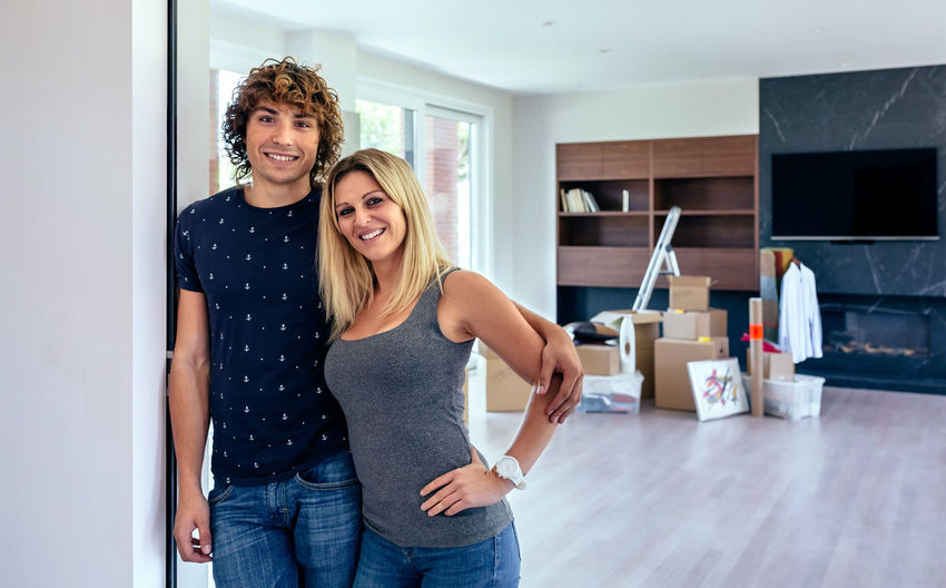Portrait Of Smiling Couple Standing At Home