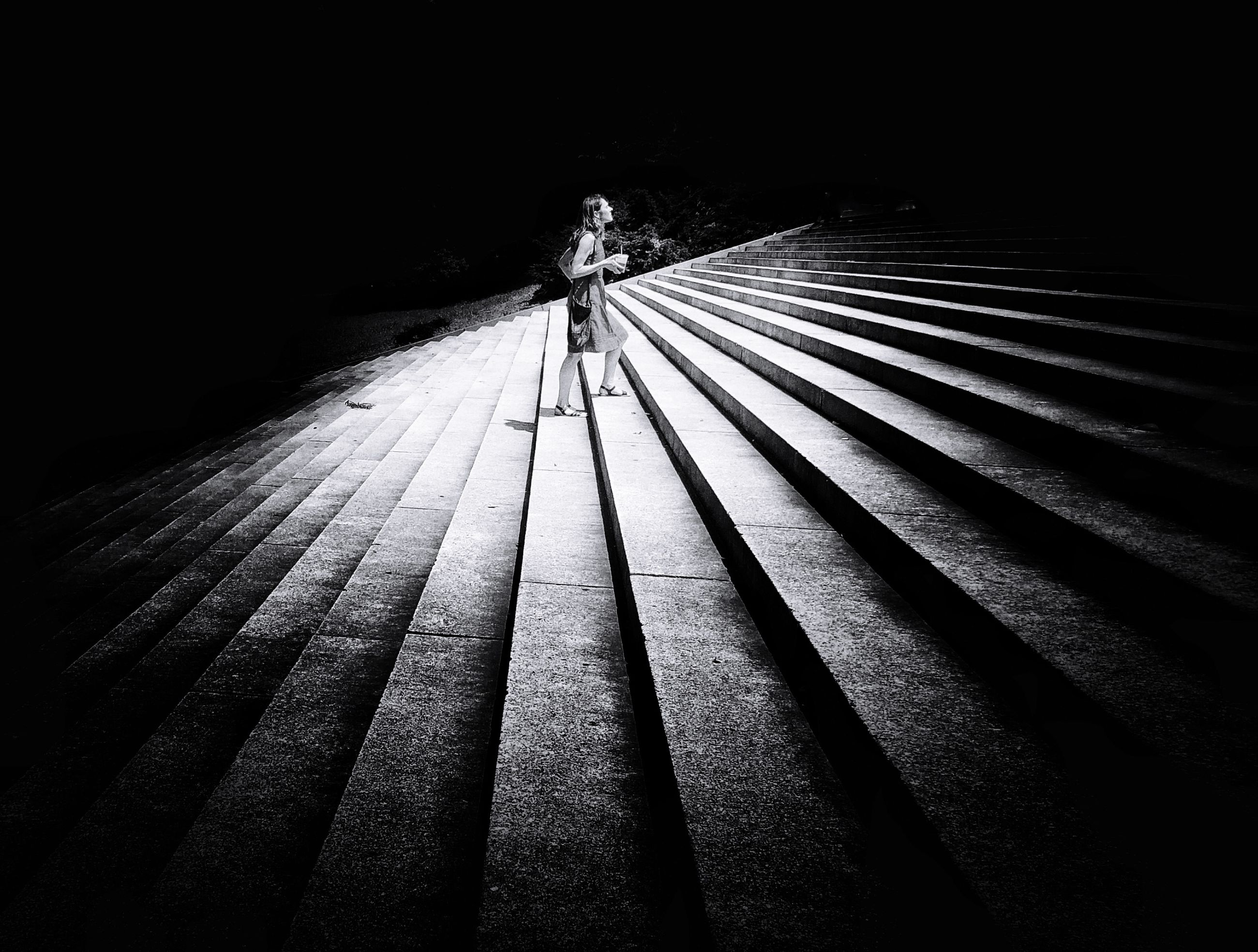 one person, shadow, walking, full length, pattern, rear view, real people, architecture, lifestyles, the way forward, high angle view, nature, night, staircase, men, outdoors, leisure activity, direction, dark