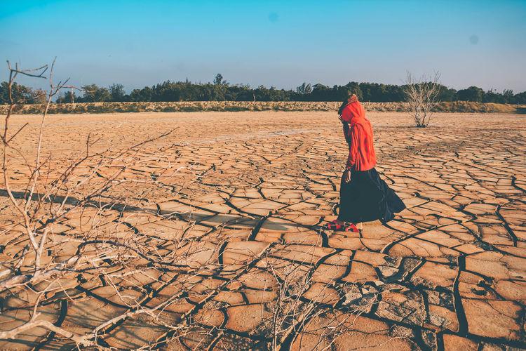 Woman walking on land