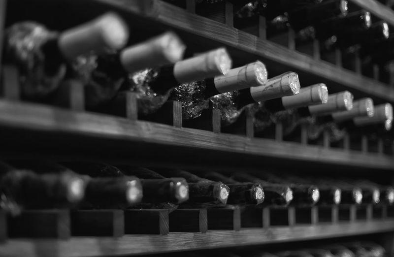Full frame shot of wine bottles in shelf
