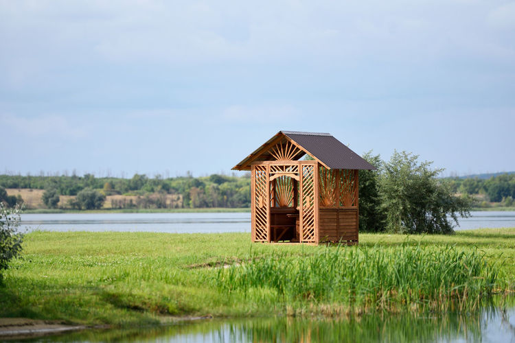 Ancient Architecture Grass Green Nature Photography Sunny Travel View Arbor Blue Sky House Lake Landscape Near Park Pavilion Relaxation River Sky Summerhouse Temple Village Water Wood - Material Wooden House