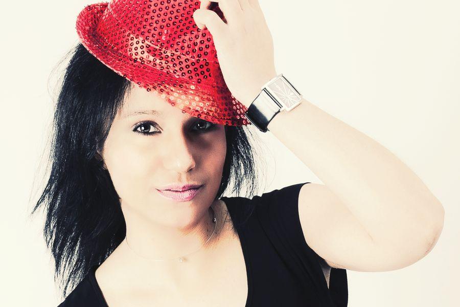 Headshot Beauty One Woman Only Blackhair Womanportrait Selfportrait Redhat Fashion White Background Shopaholic Glamour