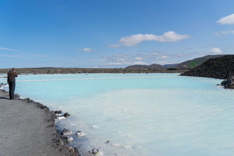 Water Sea Sky Beauty In Nature Scenics - Nature Beach Land Tranquility Tranquil Scene Blue Nature Day Real People Cloud - Sky Non-urban Scene Mountain Idyllic Outdoors Holiday Salt Flat