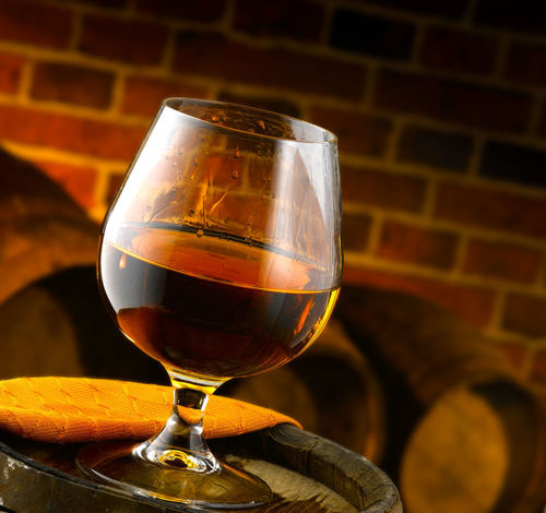 goblet of brandy in small cellar Glass Art Alcohol Alcoholic Drink Barrel Brandy Close-up Cognac Day Drink Drinking Glass Focus On Foreground Food And Drink Freshness Glass Indoors  No People Red Wine Refreshment Still Life Table Wine Wine Cask Wineglass Winetasting Wiskey