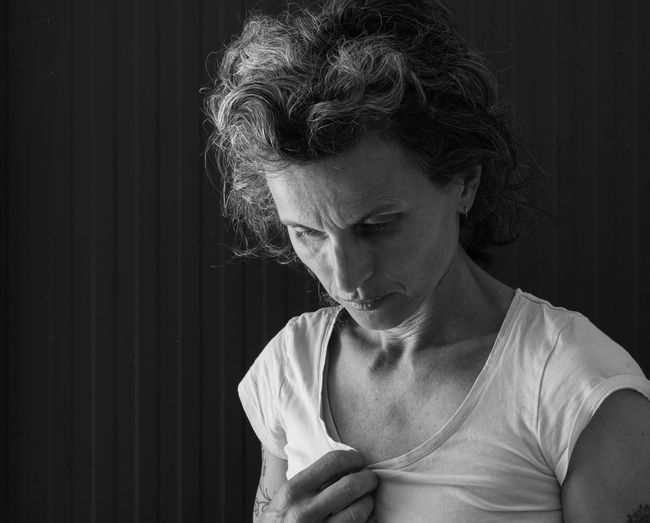 Woman (black and white) Adult Black And White Casual Clothing Close-up Contemplation Focus On Foreground Front View Hairstyle Headshot Indoors  Leisure Activity Lifestyles Looking Looking Away Looking Down Mature Women One Person Portrait Real People