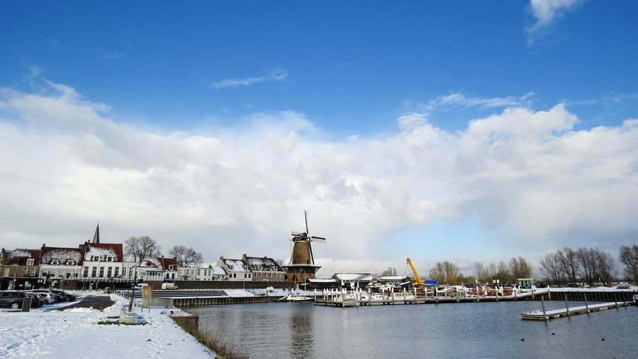 hometown2017 Dutch Landscape Dutch Holland Wijk Bij Duurstede Dorestad Mill Windmill History Clouds And Sky Cloudporn Snow Snow ❄ Business Finance And Industry No People Cityscape Water Harbor Industry Cold Temperature