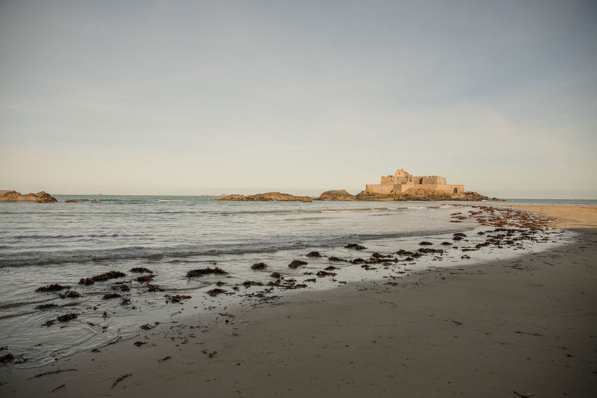 Saint-Malo beach with a view on Fort National Atlantic Ocean Bretagne Brittany Coastline English Channel France Saint-Malo Beach Coast Corsair City Empty Fort National Horizon Over Water Ille-et-vilaine Monument No People Outdoors Sand Scenics Sea Shore Sky Tranquility Travel Destinations Water