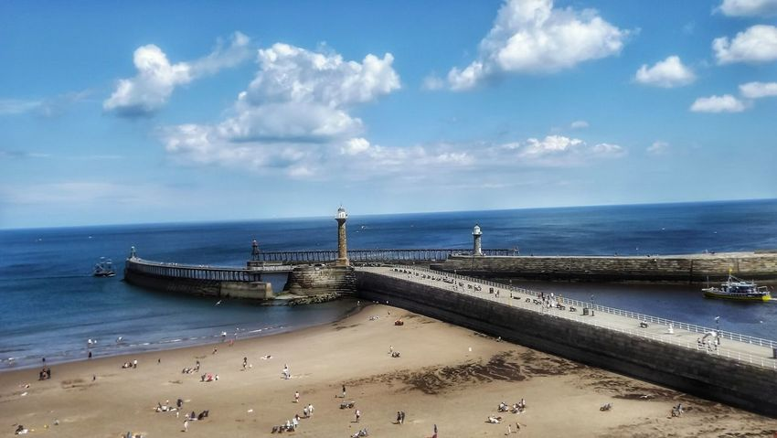 Whitby pier and Beach Horizon Over Water Cloud - Sky Beach Sea Sand Travel Destinations Scenics Beauty In Nature Landscape Sky Blue Outdoors The World Through My Eyes Creative Light And Shadow Malephotographerofthemonth Fujifilm Masterclass Water Whitby View Yorkshire Coast Whitby North Yorkshire Whitby Architecture Built Structure Vacations