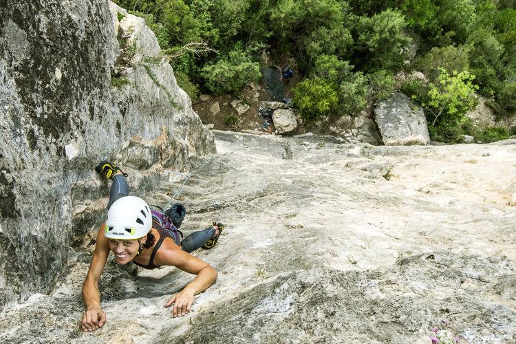 Portrait of woman rock climbing