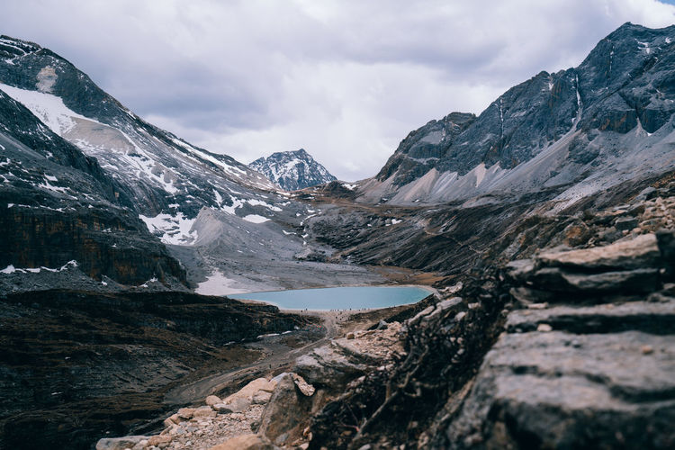 Mountain Sky Beauty In Nature Environment Landscape Cloud - Sky Snow Cold Temperature Nature Scenics - Nature Mountain Range Water Wilderness No People Day Scenery Lake Winter Outdoors Ice Snowcapped Mountain Mountain Peak Yading China Perspectives on Nature