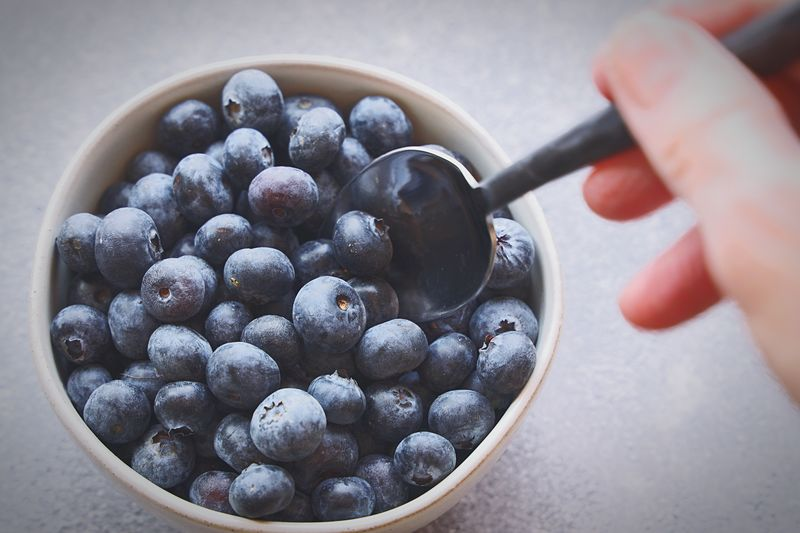 Eating blueberries Blueberries Human Hand Food Hand Food And Drink Human Body Part Healthy Eating Bowl One Person Body Part Freshness Fruit Wellbeing Close-up Berry Fruit Holding Kitchen Utensil Indoors  Real People Finger Human Finger