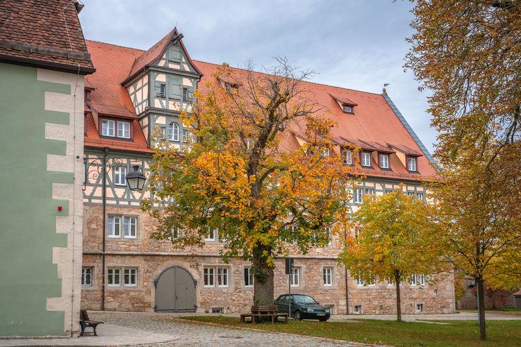 Buildings against sky during autumn