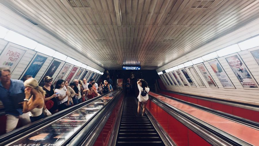 People on escalator in subway station