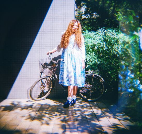 Full length of woman with bicycle
