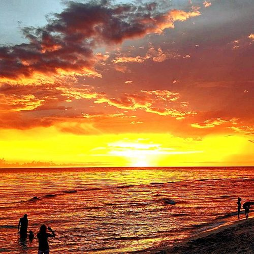 Summer Tranquil Scene Travel Destinations Sunny Landscape Vacations Sky Cloud - Sky Water Sea Sand Beach Sunlight Wave Low Tide Horizon Over Water Sunset People