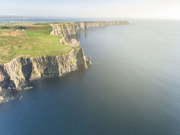 aerial view from the cliffs of moher in county clare, ireland Aerial View Architecture Beauty In Nature Cliffs Of Moher  County Clare Day Horizon Over Water Ireland Ireland Countryside Irish Landscape Nature No People Outdoors Scenics Sea Seascape Sky Tranquil Scene Tranquility Travel Destinations Water Wild Atlantic Way