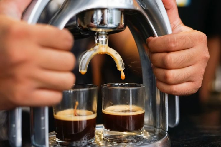 Cropped image of man pouring coffee in cup