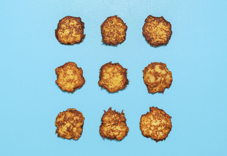 High angle view of cookies against blue background