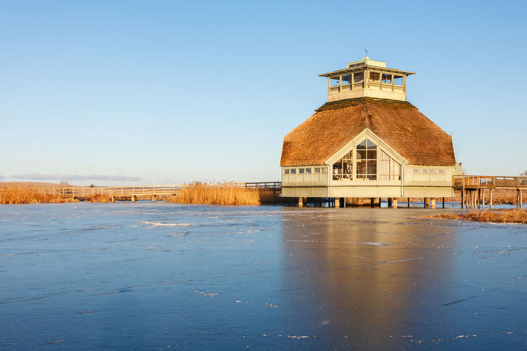 Visitor center at lake hornborga with ice on the lake