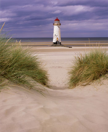 Talacre Beach Talacre Lighthouse Talacre Lighthouse Lighthousephotography Beach Sky Tower Sea Sand Architecture Guidance Direction Nature Built Structure Building Exterior Water Cloud - Sky Scenics - Nature Safety Tranquility Horizon Over Water No People Outdoors Marram Grass