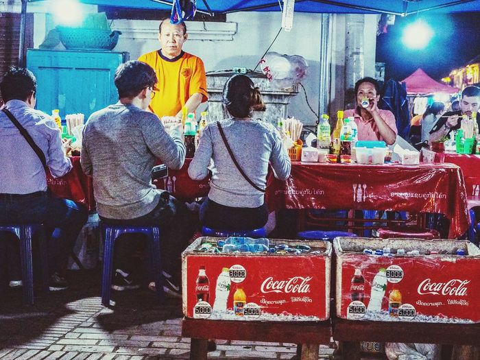 Colourful Street Illuminted Luang Prabang Colour Photography Olympuspenf Street Photography Street Food Vendors Street Food Market Laos Old City Night Street Food Stall Group Of People Real People Adventures In The City Lifestyles Crowd Enjoyment Small Business Rear View Occupation