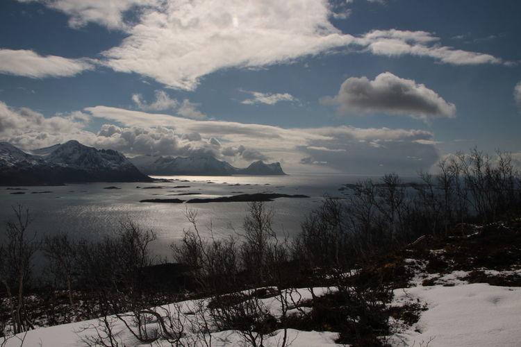 Beauty In Nature Cloud - Sky Cold Temperature Day Fjord Island Landscape Majestic Mountain Mountains Nature Nature No People Outdoors Scenics Sea Sea And Sky Sky Snow Sun Tranquil Scene Tranquility Weather Winter Winter