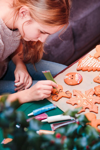 Close-up of girl decorating cookies