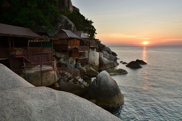 Sunset in Koh Tao. Surat Thani province. Thailand Koh Tao Koh Tao,Tao Island,Southern Thailand Thailand Thai Southeastasia Southeast Asia Surat Thani Province Chumphon Archipelago Island Sunsetporn Tropical Climate Tropical Sunset Gulf Of Thailand Amazing Thailand Bungalow Seascape Asian  Coast Boulder Boulders Tourism Destination Travel Destinations Water Sea Rock Architecture Rock - Object Built Structure Scenics - Nature Beauty In Nature Beach No People Building Exterior Nature Tranquil Scene Horizon Over Water Outdoors Building Sun