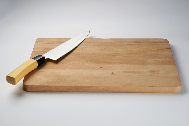 High angle view of knife on table against white background