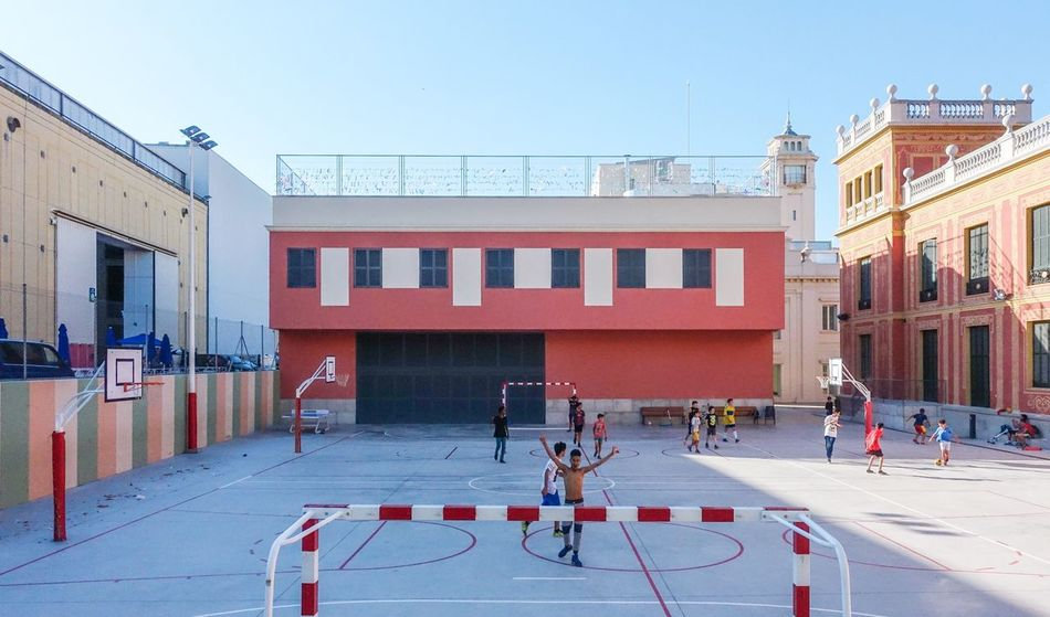 Sport and the city... Urban Lifestyle Vorfreude WM2018 Soccer Barcelona City Kids Architecture Building Exterior Built Structure Sky Group Of People Clear Sky Real People City Lifestyles Building Sport Adventures In The City Focus On The Story