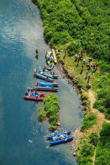 High angle view of people on boats in river