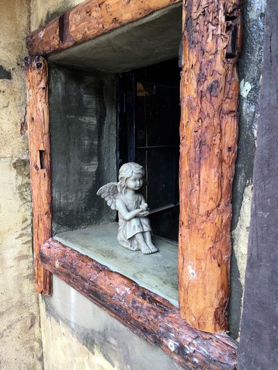 Little Angel in Wooden Window at Dapeng Ancient Village in Shenzhen, China Angel Little Angel Window Figurine  Holy Religion Religious  Religious Art Dapeng Ancient Village Dapeng Shenzhen China Chinese Food Ancient Village Chinese Village Village Street Photography Angel Wings