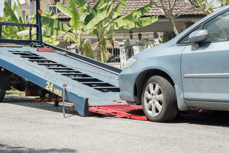 A car being pulled up to the tow truck. 24 Hours Lorry Road Service Tow Truck Towing Workshop Accident Broken Car Damaged Drive Insurance No People Outdoors Protection Pull Repair Stationary Street Transportation Vehicle