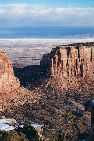 Colorado National Monument FInd me on IG @noeldxng Be. Ready. Perspectives On Nature Beauty In Nature Beauty In Nature Cliff Cloud - Sky Day Geology Landscape Nature No People Outdoors Physical Geography Rock - Object Rock Formation Scenics Sky Snow Tranquil Scene Tranquility Travel Destinations